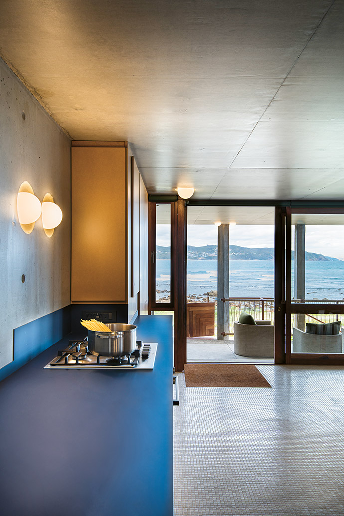 Basic ball lights recessed into the concrete are a functional yet stylish design feature throughout the house.