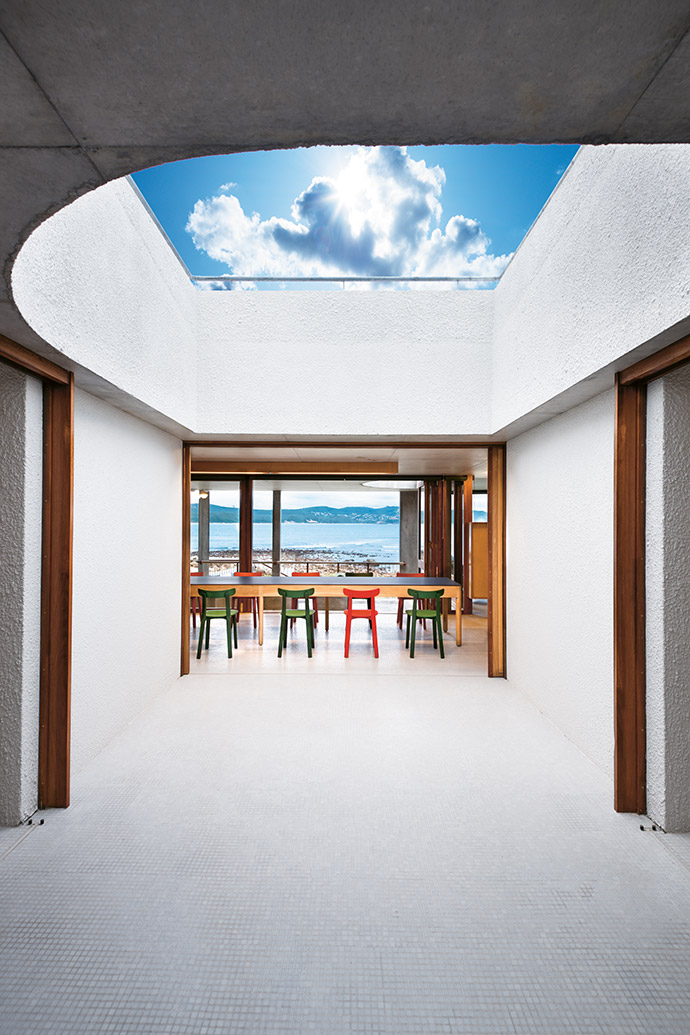 Flooded by light courtesy of the building's architecture, this inner courtyard maximises the views outside, while also offering protection from the howling southeaster. Mosaic tile flooring has been used throughout to create the consistent feel of being surrounded by water.