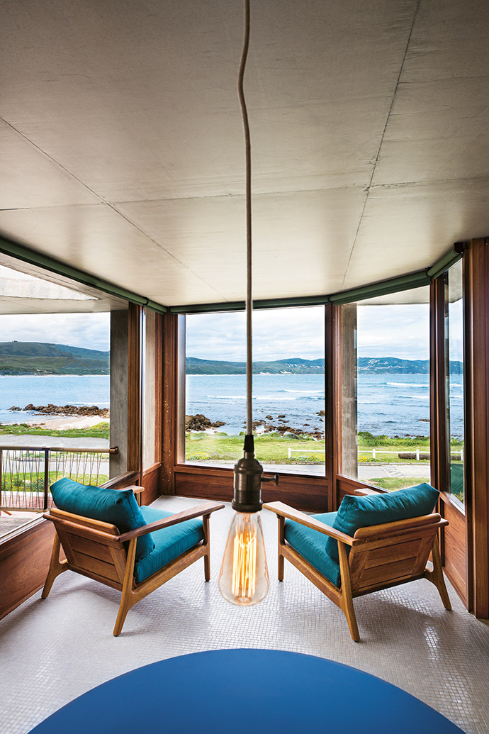 """The angled """"bay window"""" at the front of the building, with discreet roller blinds that retract to reveal magnificent views, creates a cosy reading nook."""