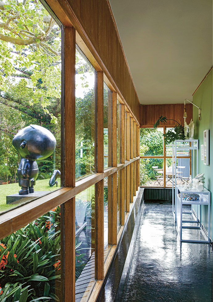 The walkway to the sleeping area allows the family to become part of the garden, no matter the weather.