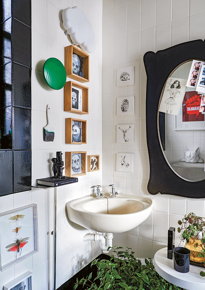 A corner of the guest bathroom serves as yet another display space for the family's collectables.