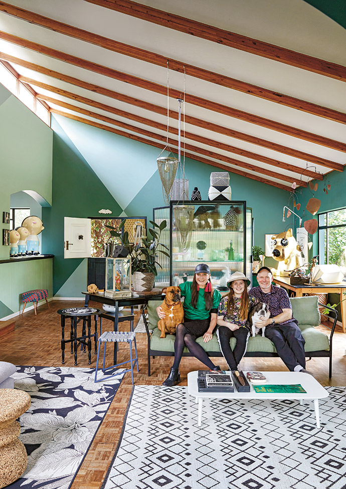 Owner Tracy Lynch with daughter Franny, husband Frank, and dogs Truffle and Timber, in their living room. The sofa frame is by Pedersen + Lennard, with linen Fabric House cushions and upholstery by MMJ Interiors. The two rugs are Haus by Hertex.