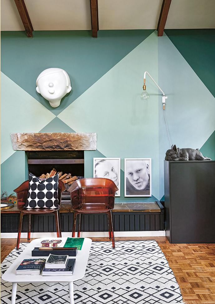 Tracy transformed the walls with two shades of green mixed to spec by Plascon. Above the stone plinth – all that's left of the original fireplace – is one of Frank's Raintaster sculptures. The light is by Pedersen + Lennard, and the two Papyrus chairs are by the Bouroullec brothers.