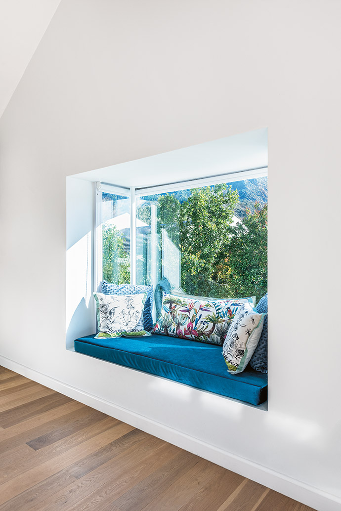 A sun-bathed window seat is the perfect spot to get lost in the views.
