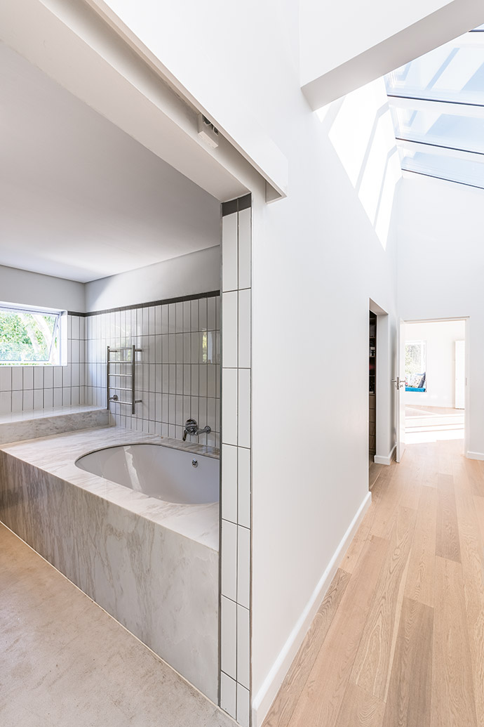 Bathroom tilework by Florstore OnTrend is complemented by Hansgrohe chromeware.
