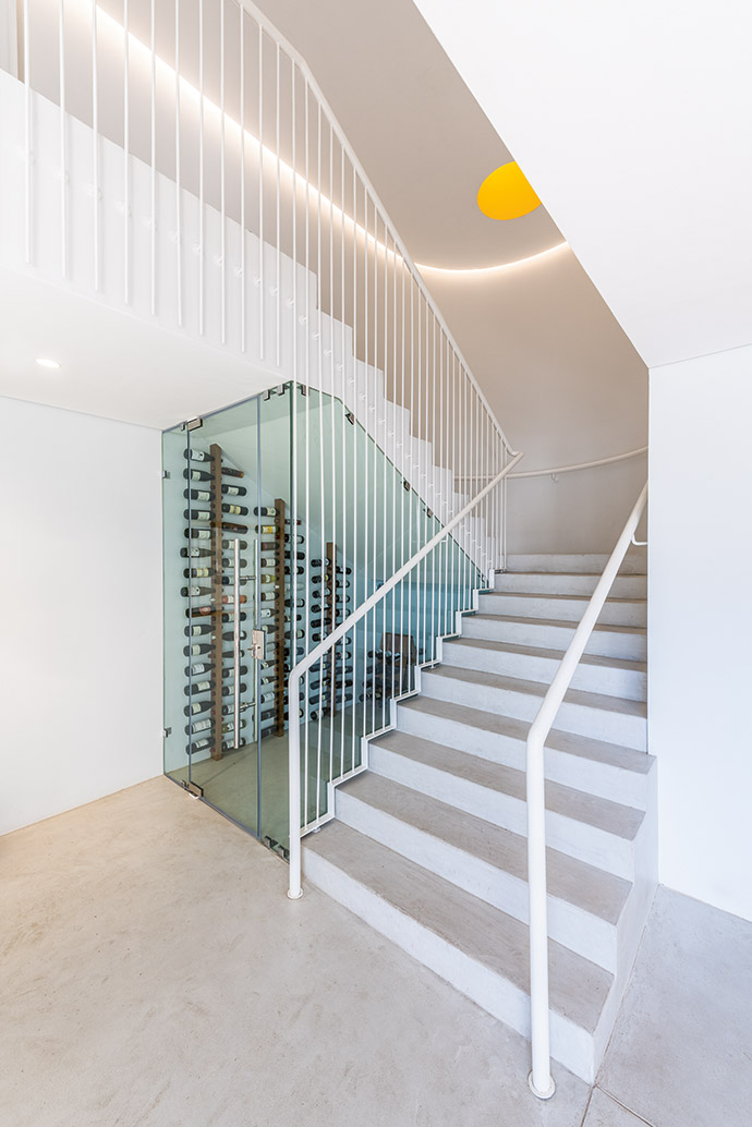 Climate-controlled wine storage, cleverly tucked in next to the staircase, is an example of the functional decor.