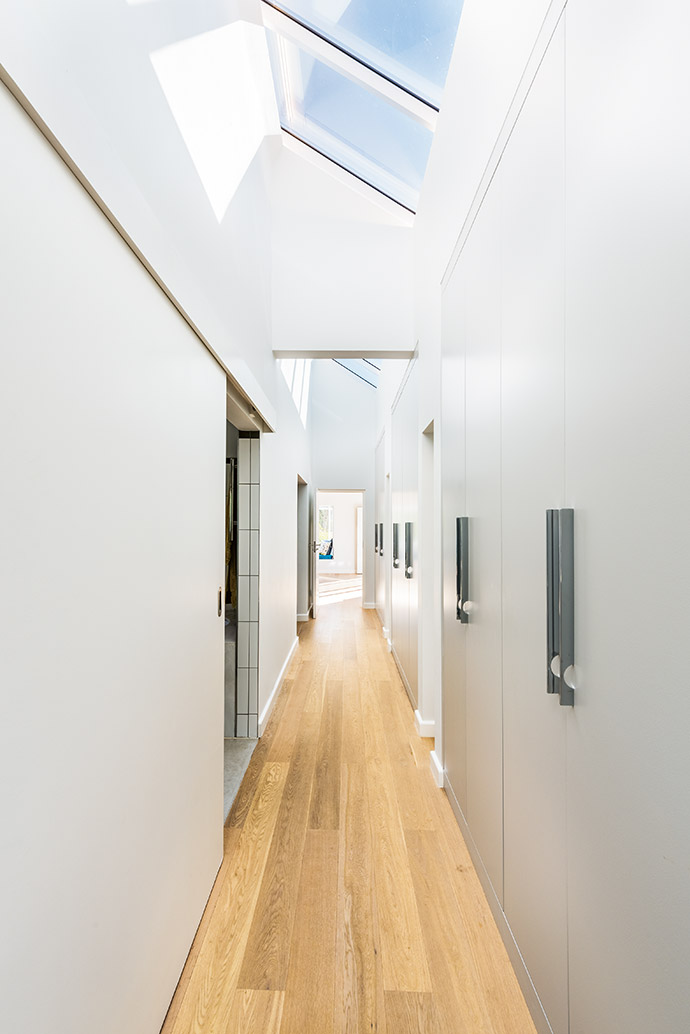 A sleek passage connects the main bedroom to its en suite and walk-in closet.