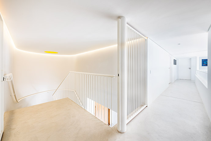 The staircase connects the open-plan ground floor to the bedroom level.