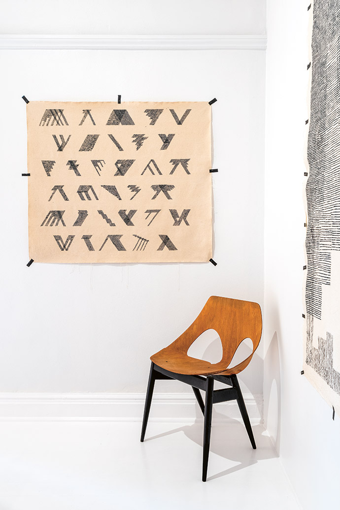 A Jonah Sack work hangs above a Jason chair by Carl Jacobs and Jason Guille for Kandya.