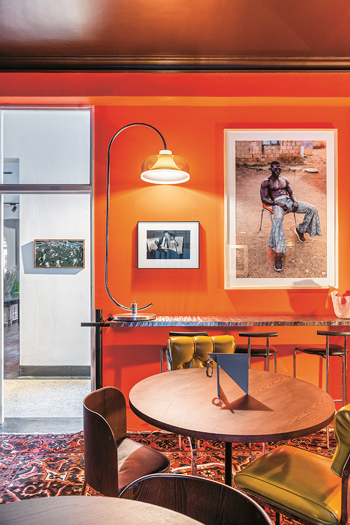At the Negroni Bar, a black-and-white photograph by Billy Monk hangs between a work by Daniel Malan in the passage and a photo by Tatenda Chidora (BKhz Gallery). The sculpture on the table is by Michael MacGarry.