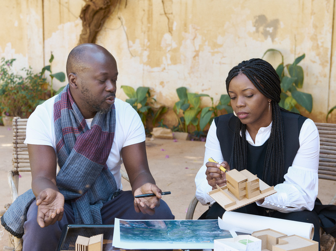 David Adjaye, Mentor with Mariam Kamara, Protégée in architecture, working on their project at Atelier Masomi.  Niamey, Niger. January 2019