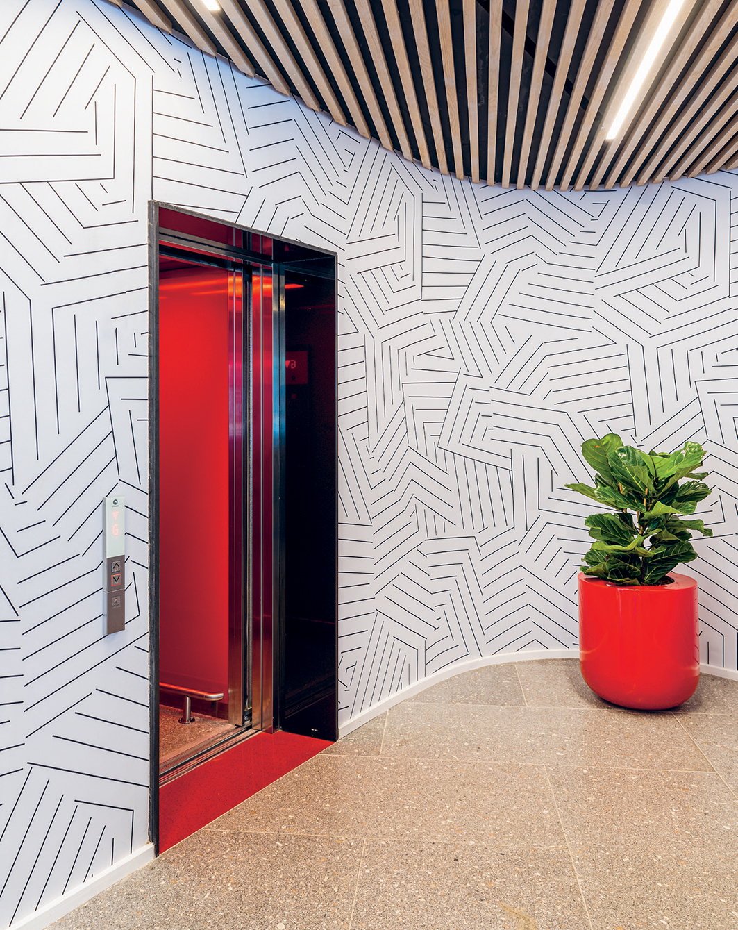 A Styler planter is offset by Cara Saven's Missing The Point wallpaper.