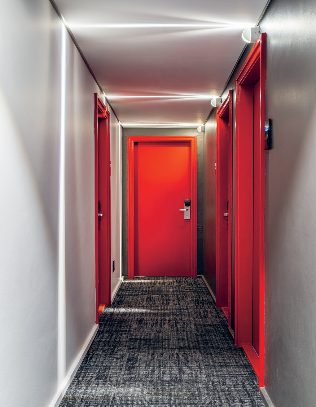In the narrow hallways, stony-grey carpet tiles by Interface were sourced from KBAC Flooring.