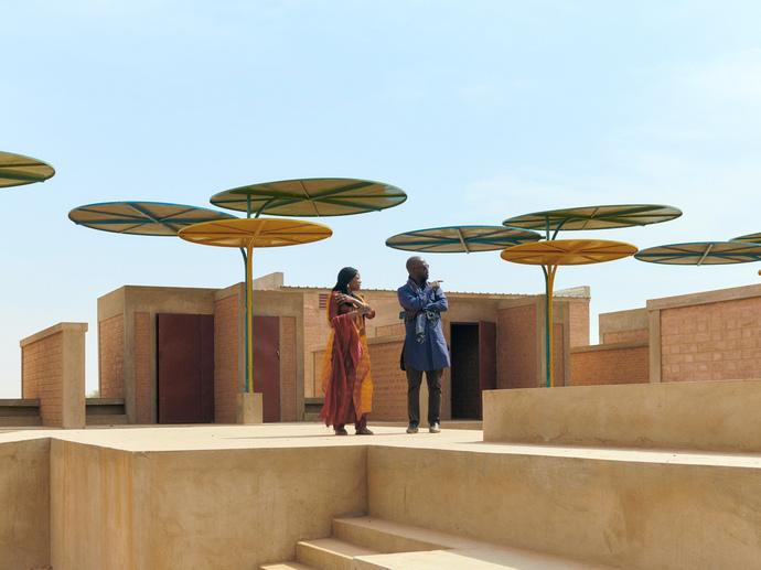 David Adjaye, Mentor with Mariam Kamara, Protégée in architecture, visiting the Regional Market of Dandaji.  Dandaji, Niger.