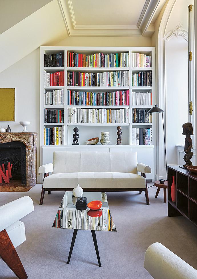 Emmanuel designed the built-in bookshelf himself.