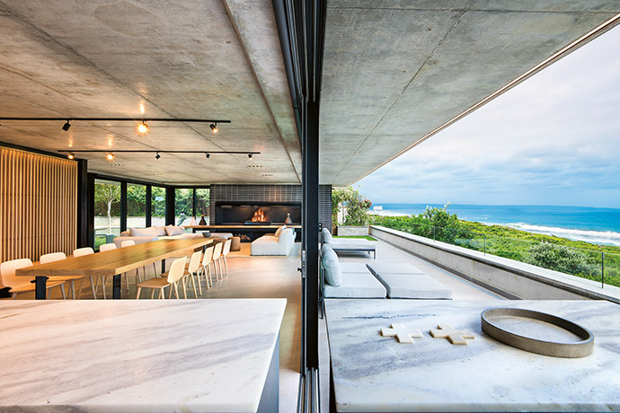With views at the heart of its design, the entire stoep of this Plettenberg Bay home is seamlessly claimed as extended living space.