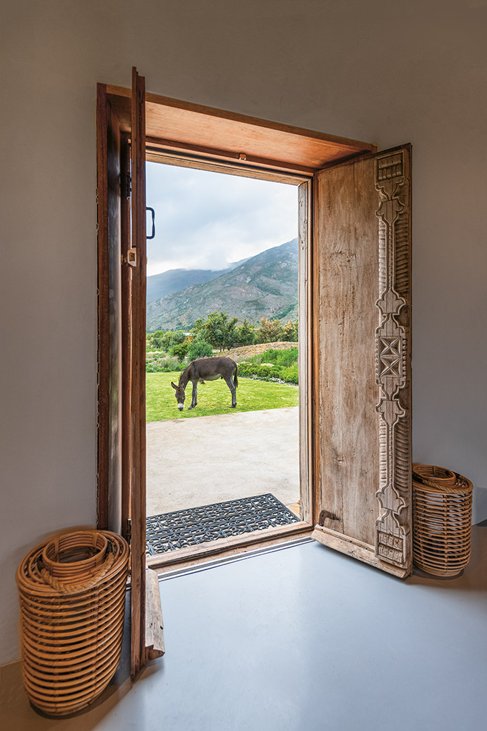 The ornately carved front door is the perfect foil to the simplicity within.