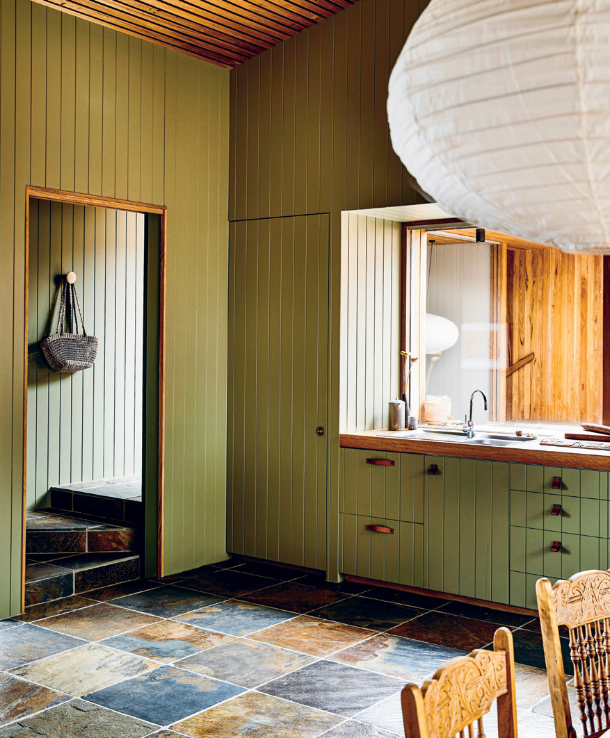 """""""We've used a range of green shades to complement the natural timber and slate,"""" says architect Patrick Kennedy of the harmonious palette."""