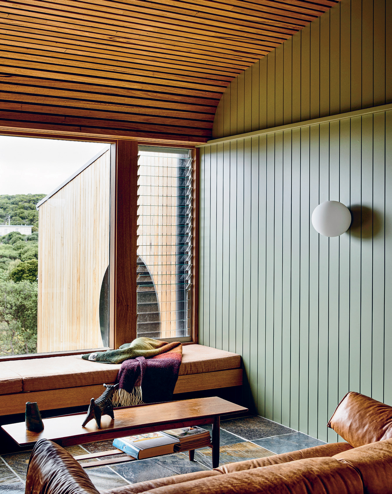Timber-clad walls and ceilings achieve a sense of cohesion with the exterior, and bring warmth and robustness to the interiors.