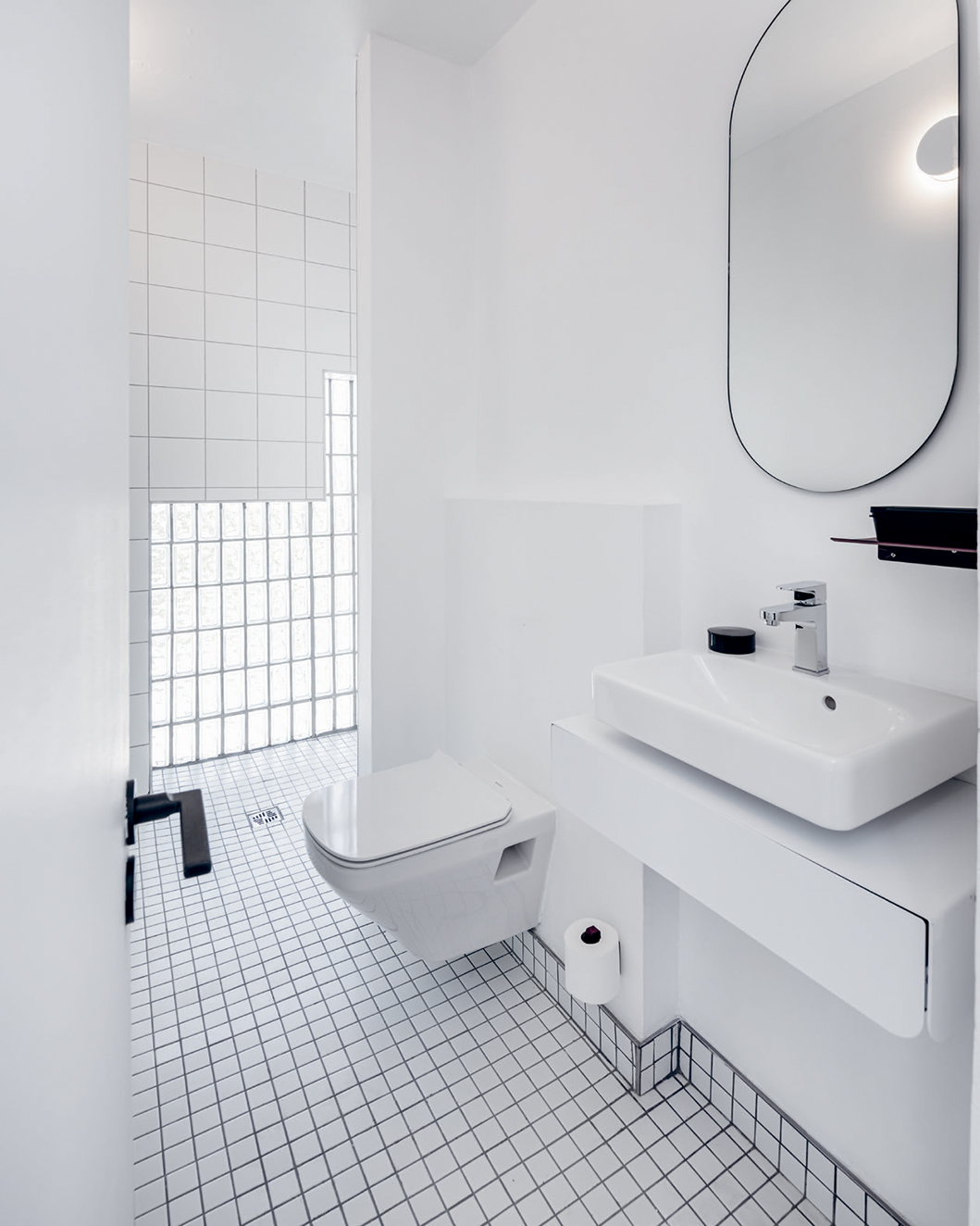 Bold striped floors create a mesmerising optical illusion; simplicity and functionality reign supreme in the bathrooms.