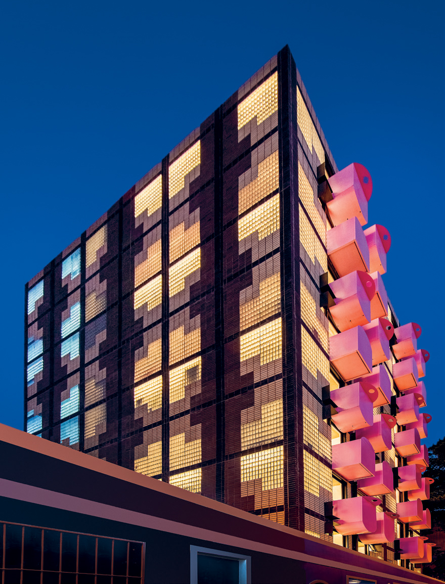 The building's tapestry-inspired exterior is brought to life at night.