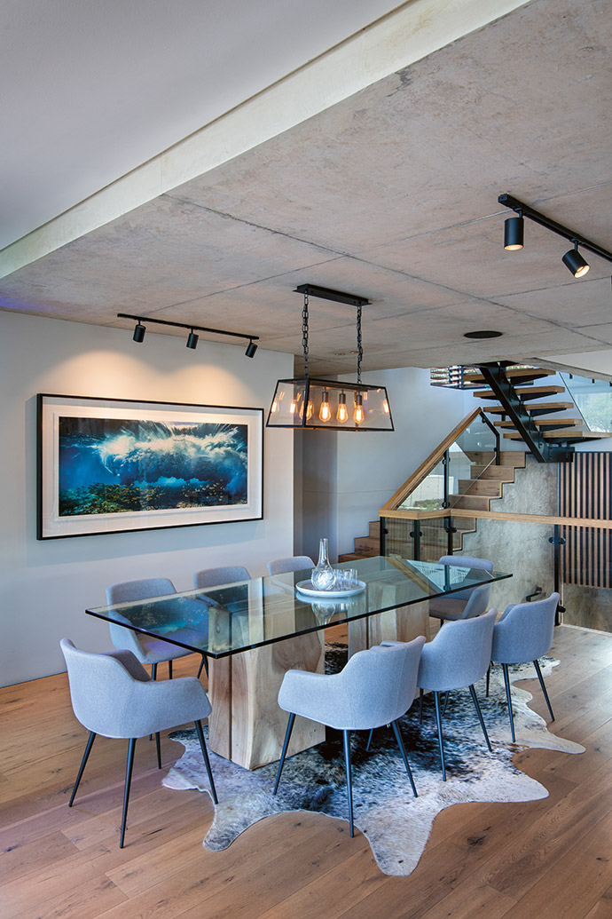 The focal point of the dining room is a photograph by Sacha Specker, which displays the raw power of the Atlantic Ocean.