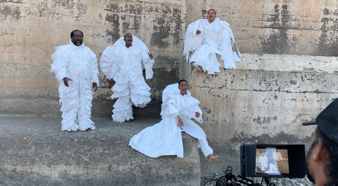 Four singers from Graaff-Reinet on the wall of the Nqweba Dam during filming. From L to R Allan Hoffan, Limweli Thamsanqa Innocent Swellendam, Therlow Baai and Wesley Adams.