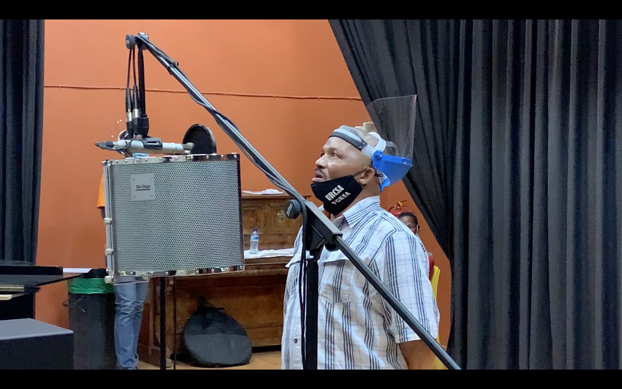 Neville Oormeyer, seen here recording his voice for the first time, during the weeklong creative workshop with singers and musicians from Graaff-Reinet, held at the John Rupert Theatre.
