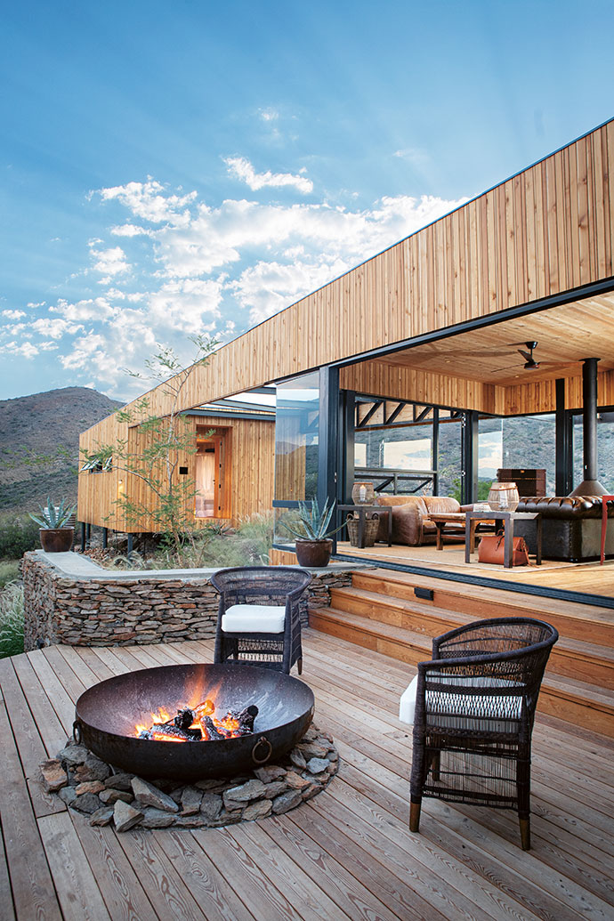 Built with indoor-outdoor flow in mind, the central lounge opens up fully to the deck area, where a firepit designed by The Fire Pit Company becomes a natural place to gather and socialise.