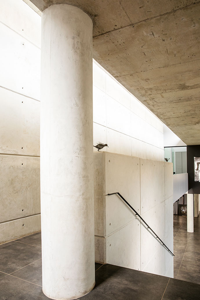 The exposed concrete of the interior is partly inspired by Japanese architect Tadao Ando.