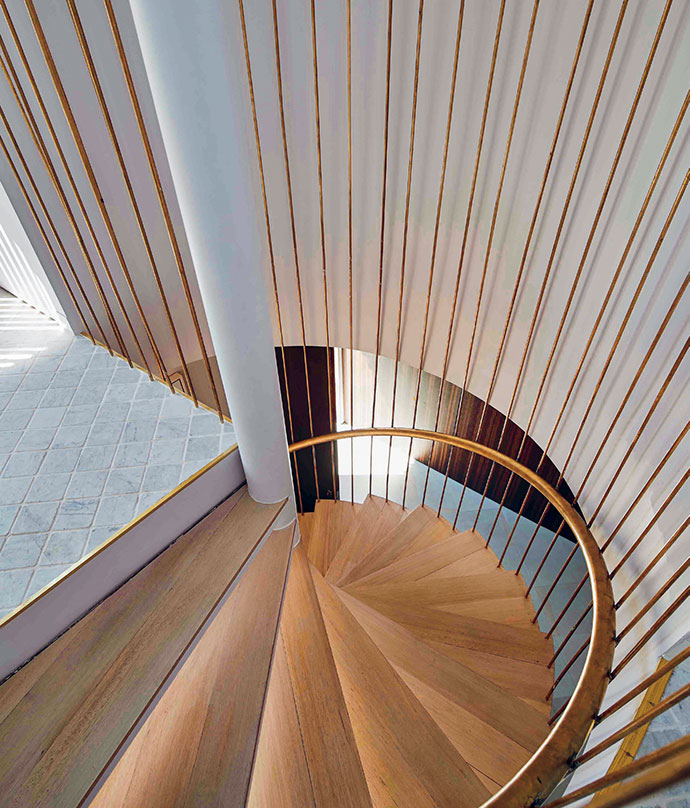 The brass-and-oak staircase is a piece of functional art.