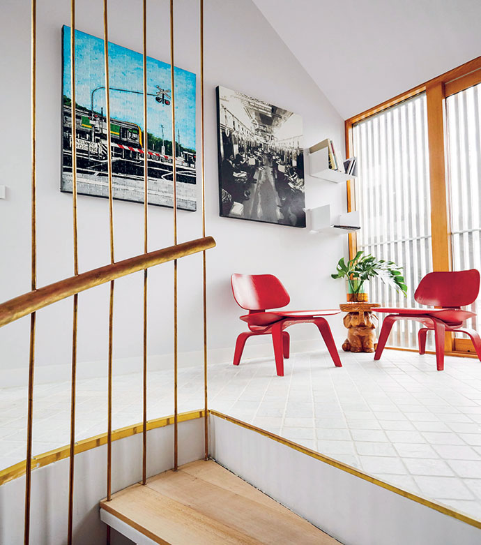 Two Eames LCW chairs line the upstairs landing – a stopping-off point that Mannix often uses as a play area – and are overlooked by artworks by Edward Puzon (left) and Kirpy.