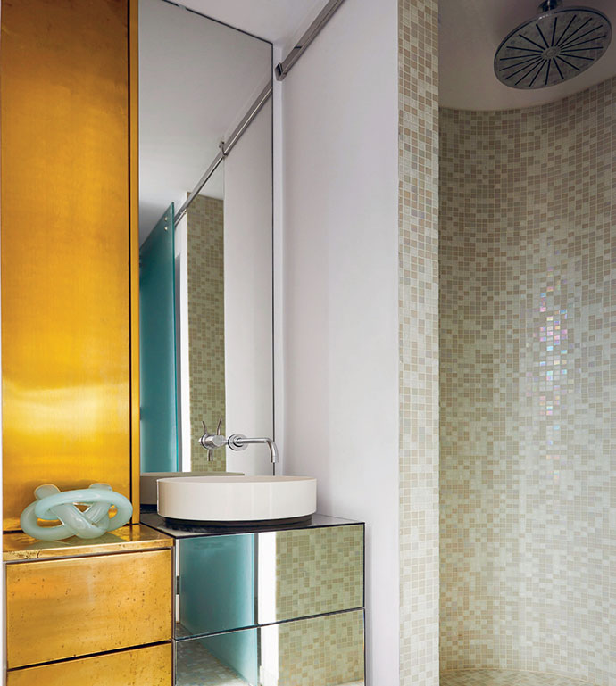 The brass theme continues in the main en suite bathroom with a custom vanity by Seventy7 Projects.