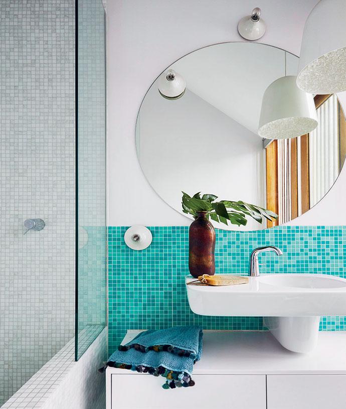 Glass mosaic tiles provide a bright, fresh take on bathroom design.