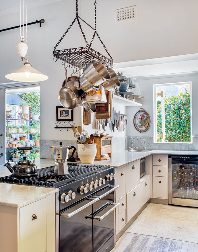 Counters of Carrara marble add warmth and patina to the kitchen