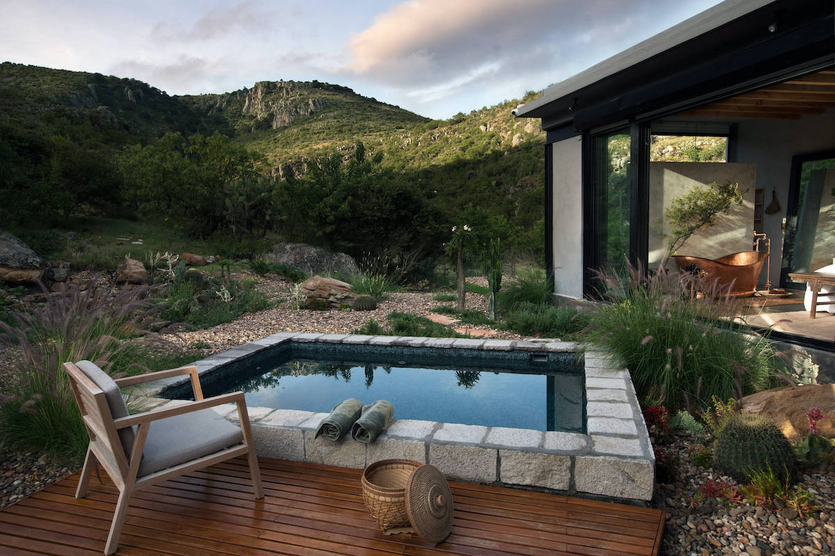 A solar-heated pool is featured on the property.