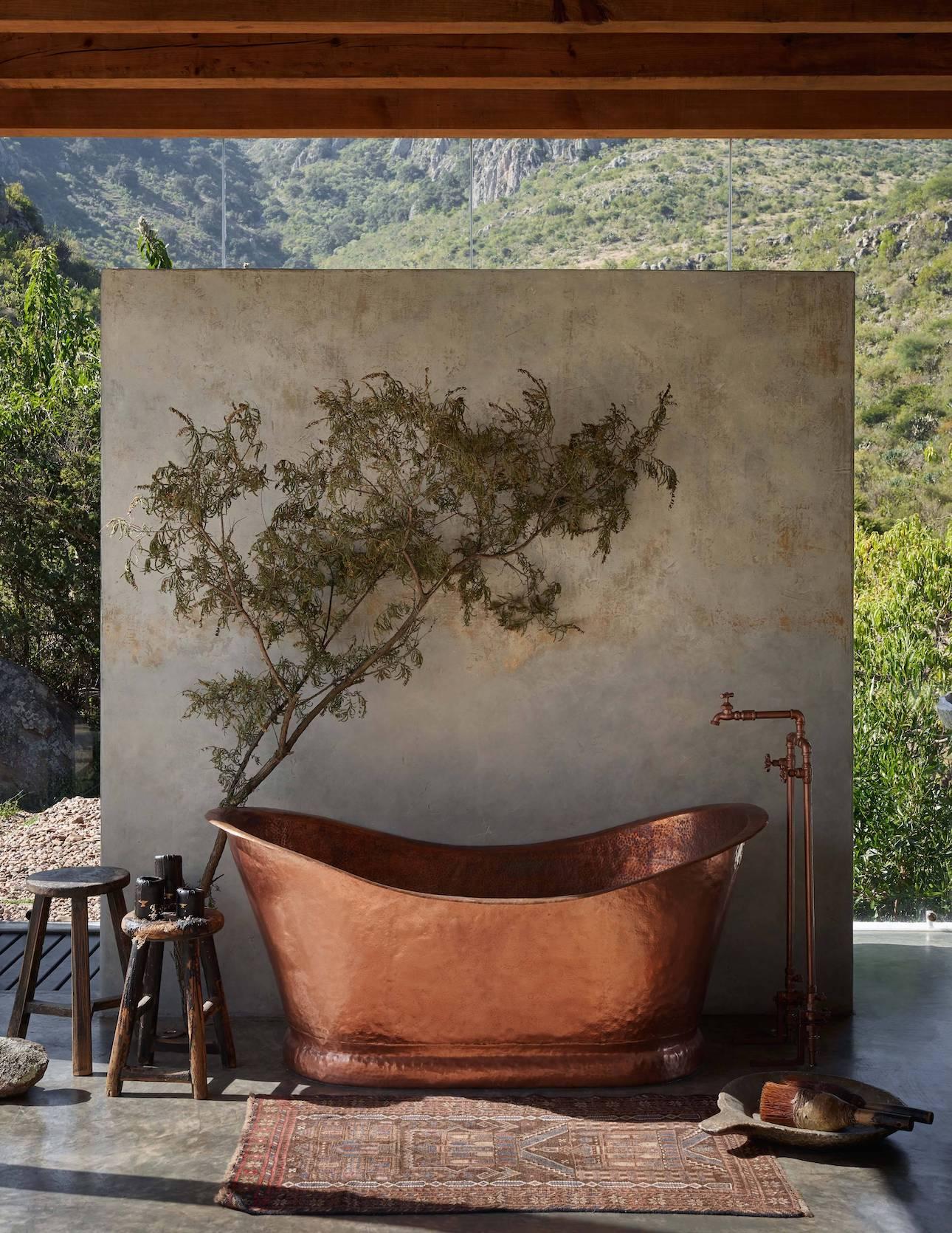 The property has a stunning copper bathtub.