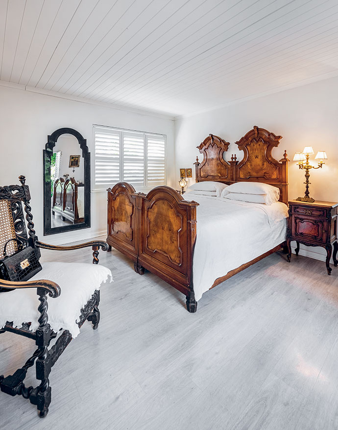The impressive walnut bed was sourced in northern France, and displays the region's strong Germanic characteristics. A 150-year-old French hunting chair holds the corner space.