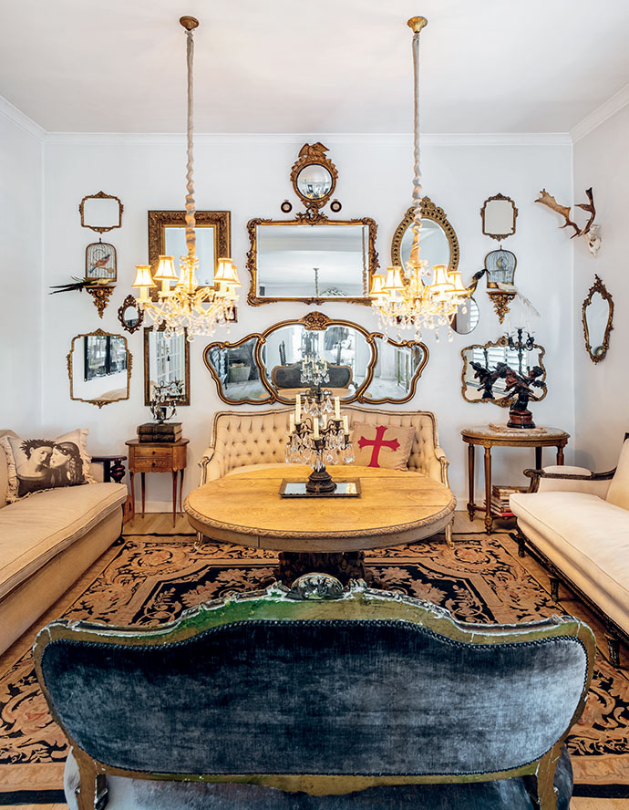 Marti's whimsical collection of vintage and antique mirrors, sourced at auctions, acts as a focal point in the living room.