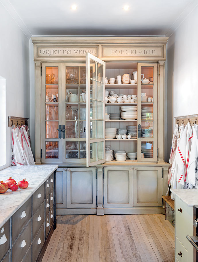 A custom-made French-style cabinet houses crockery for entertaining.
