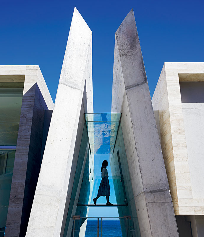 Cathedral-like in their design, the two concrete planes rise skywards, marking the entrance to the house.
