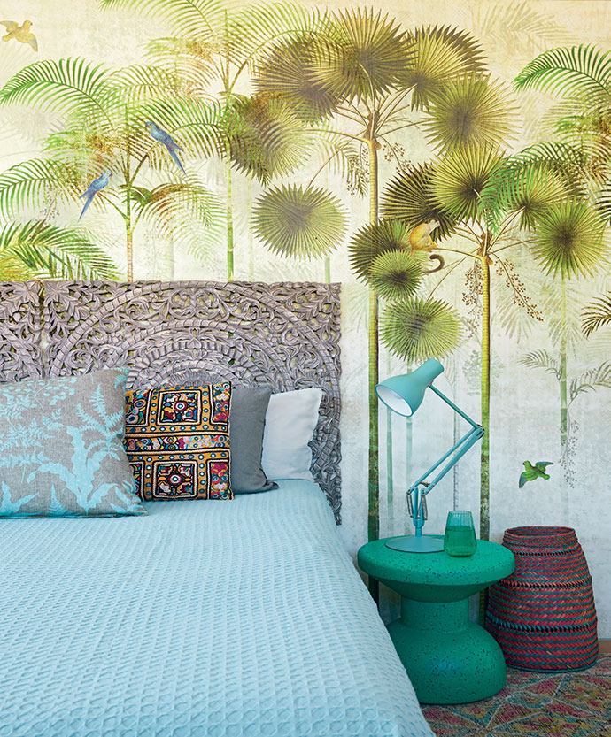 The wallpaper in 13-year-old Georgia's bedroom is by Hertex and the carved headboard is from Moroccan Warehouse.
